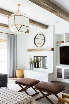 Living room remodel in a California home. Living room design and inspo. Wood beams, dark wood floors, white walls. Living room built ins. White brick fireplace. | Studio McGee Blog