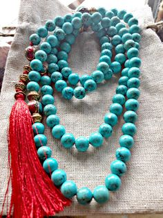 Immerse and transform yourself in the ancient spiritual tradition of #Mala #Meditation with a #VividLifeMala.   Tibetan Style Mala with Turquoise (Spiritual Meaning, Protection) Tibetan Coral and Turquoise Marker Beads (Spiritual Meaning, Healing) handmade in Nepal., Antique Gold Spacers and 100% Silk Tassel. Mala handmade in Canada and thread with 100% silk.