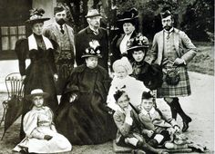 A gathering at Balmoral, September 1895. Standing left to right: Princess Helena Victoria of Schleswig-Holstein, Prince Henry of Battengerg, Sount Arthur Mensdorff-Pouilly, Princess Henry of Battenberg, the Duke of York. Seated: Princess Victoria eugenie of Battenberg, Queen Victoria, the Duchess of York holding Prince Edward, Prince Arthur of Connaught and Prince Alexander of Battenberg