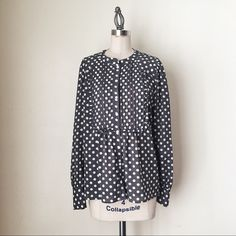 "J CREW | Gray Polka Dot Top FEATURES:  *Mandarin collar  *Long sleeves  *Button cuffs  *Button front  *Pleating detail on bodice  *100% polyester  MEASUREMENTS: Bust - 39"" Waist - 38"" Length - 25 1/4""  Very good condition NO SWAPS/TRADES/RESERVES J. Crew Tops Blouses"