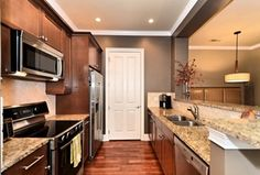Contemporary Kitchen with specialty door, Galley, Limestone Tile, Flat panel cabinets, Stone Tile, Flush, European Cabinets
