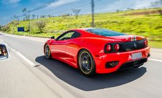 Awesome red Ferrari 360 Challenge Stradale rear side view in motion on the road; photo by Elero Automotive Photography