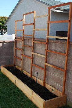 Raised garden bed with trellis-side of garage after lilacs are gone
