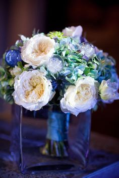 Garden rose and hydrangea bouquet with flash bulbs on Style Me Pretty (originally photographed for In Frame Bride Magazine hence the flash bulbs) blue ivory and teal winter wedding inspiration shoot
