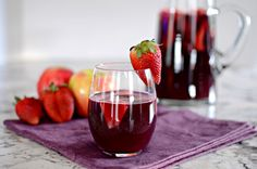A delicious and unique sangria recipe featuring almond tequila, orange juice, apples, and strawberries.