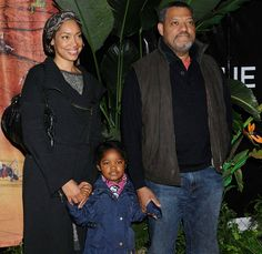 Actors Gina Torres and Laurence Fishburne and their daughter Delilah