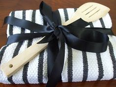 Need a bridal shower gift idea? Wrap a recipe or cookbook in a kitchen towel and attach a few utensils.