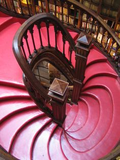 (JK Rowling's inspiration for the library in Harry Potter.) I remember it being such a struggle to get my own pictures in there. like travel# Beautiful Stairs, Beautiful Places, Livraria Lello Porto, Amazing Architecture, Architecture Design, Take The Stairs, Stair Steps, Stairway To Heaven, Spiral Staircase