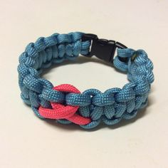Pink Ribbon Cancer Awareness Paracord Bracelet. Scone one, getting better. :) next is a black bracelet with a pink ribbon.... #pink #blue #cancer #paracord #paracordlife #paracordbracelet #cancersucks #cancerawareness #ribbon #breastcancerawareness