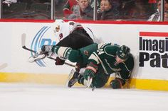 Chicago Blackhawks at Minnesota Wild - 12/05/2013 - W 4-3 Matt Cooke of the Minnesota Wild collides with Jonathan Toews of the Chicago Blackhawks at Xcel Energy Center in St. Paul, Minnesota.  (Photo by Bruce Kluckhohn/NHLI via Getty Images)