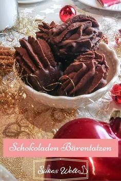 Sie dürfen auf keinem Plätzchenteller fehlen. Schokoladige Bärentatzen mit Nougatfüllung. Ich zeige Dir wie Du diese leckeren Schokoladenplätzen backen kannst. Sie sind ganz einfach aber dafür umso leckerer. Schau Dir das Rezept an. #silkeswelt #bärentatzen #weihnachtsplätzchen