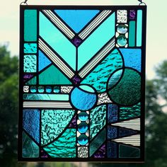 Blues, greens and purple stained glass panel