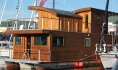 The little cabin boat or mini yacht that you see here is Adventure Craft's Have you ever seen one of these before? They like to describe it as a Tiny Cabins, Cabins And Cottages, Mini Yacht, Utility Boat, Lakefront Property, Floating House, Floating Boat, Little Cabin, Boat Design