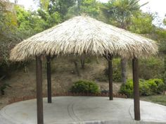 This Four Pole Tiki Hut can be used to cover Jacuzzi, BBQ, dining, and bar areas in your home or business setting. Our tiki hut measures 13 feet in diameter and gives shade to a 13 foot area. Tiki Hut, Backyard Plan, Backyard Landscaping, Backyard Ideas, Patio Ideas, Cabana, Chicken Hut, Outdoor Living, Outdoor Decor