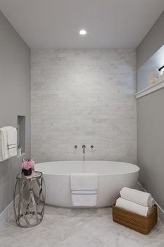 captivating stone tile bathroom accent wall ideas | Romantic bathroom features an accent wall clad in wavy ...