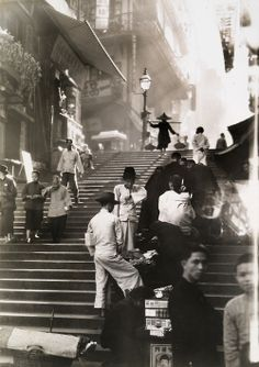 Vendors and pedestrians along a steep staircase in Hong Kong, November 1934.  W. Robert Moore, National Geographic.
