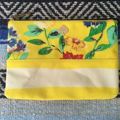 Kate Spade Willow Road Yellow Clutch Very cute clutch by kate spade featuring a fun floral and striped combo! The inside is super clean and only used 3 times. On the outside there are 2 small purple marks on the front that I could not get out. Those are the only flaws and there is a close up in the second photo.   NO Trades.  Reasonable Offers Considered! ✅ kate spade Bags Clutches & Wristlets