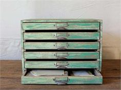Our Distressed Desktop Paper File Drawers are wide and shallow, perfect for storing paper, forms, craft and scrap-booking supplies and so much more. Inspired by antique flat file cabinets, this smaller version is designed to sit on a desk or countertop. The aged green finish and vintage style label holders make this ideal storage for a rustic home office. Made of wood with metal label holders.