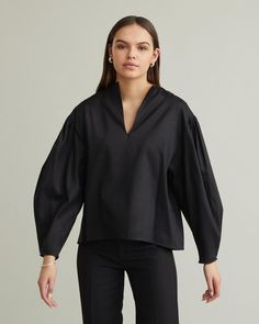 Balloon sleeve blouse featuring a slit neckline and a dropped shoulder. Long balloon sleeves with pleats Slit neckline Straight fit Dropped shoulders lyocell cotton Model is ft 9 in and is wearing a size S Long Balloons, Jil Sander, Acne Studios, Designing Women, Fashion Brands, Neckline, Apothecary, Blouse, Sleeves