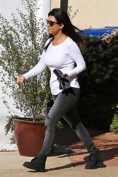 Kourtney Kardashian wearing Splendid Thermal Henley Top Black Orchid Black Jewel Jeggings in Black Rock Timberland boots in Black