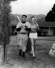 This Esquire photo is from 1951, when Marilyn Monroe visited the Chicago White Sox spring camp in Pasadena. The lucky guy: 3B Hank Majeski. It's historic for another reason: Joe DiMaggio was reading Esquire and the photo caught his eye, reportedly leading him to start asking about Marilyn.