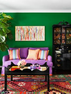 The green wall and the purple wall and the orange accessories