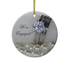 Diamond and Pearls #Engagement Round #Ornament  http://www.zazzle.com/loraseverson*  He proposed and you accepted! Celebrate your first Christmas as a newly engaged couple and commemorate the special day with the elegant Diamond and Pearls Engagement Round Ornament. Customize it with the personal names of the bride and groom and date that he popped the question. This beautiful engagement Christmas ornament features a close up photograph of a diamond #wedding ring set and white pearl…