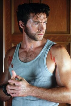 Hugh Jackman as Wolverine always reminds me of my man!! same build, tank top wearing, same scruff, and perpetual forehead grimace! lol