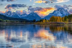 Reflections of the Tetons at Oxbow Bend; by Stacy White