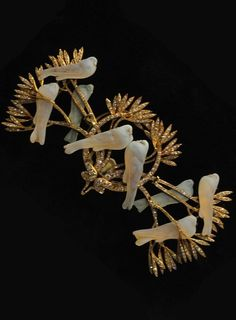 """""""Peace"""" pin, by René Lalique, given by the people of Paris to Edith Woodrow Wilson in 1919, when she accompanied the president to the Paris Peace Conference following World War I. Composed of gold, moulded glass and diamonds."""