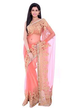 This peach net saree strikes the perfect balance between elegance and vibrancy. The saree is highlighted with heavy golden doori floral border with sequinsand pearl embellishment. Combined with matching blouse this designer saree will make you a stunner in any social gathering.