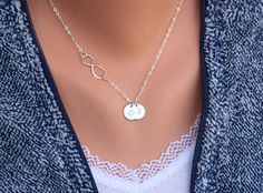 silver Infinity necklace with initial charm. I love infinity jewelry.