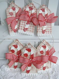 "Candy Cane Christmas Holiday Gift Tags or ornaments  (for sale) by PaperBistro on Etsy - (Could use cardstock or cardboard covered with wrapping paper and miniature candy canes!) Theses tags have a chipboard hand painted and glittered candy cane, machine stiching, ribbon and pom pom trim. Tags measure 1 3/4"" x 3 3/4""."