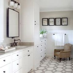 Oil Rubbed Bronze Bathroom Fixtures white vanity with black top and subway tile. would change the