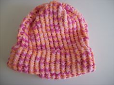 Loom knit hat made with Bernat Baby Blanket yarn. This hat would fit a teenager or adult.