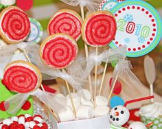 An easy and affordable way to get the look of swirly lollipops with the exact right colors for the treats table - do cookie pops instead.