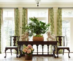 antiqued limestone floor; green drapes; foo dogs  --  You've Never Seen a'Beach House' Like This - Traditional Home