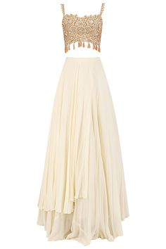 Arpita Mehta presents Ivory two layered skirt with gold blouse and dusty pink cape available only at Pernia's Pop Up Shop. Party Wear Indian Dresses, Indian Fashion Dresses, Indian Designer Outfits, Indian Outfits, Designer Dresses, Fashion Outfits, Party Dresses, Indian Tunic Tops, Designer Bridal Lehenga