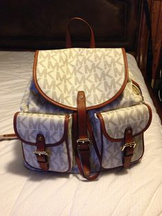 Luv my MK backpack...Even has a slot for my iPad mini!!!💼👜❤