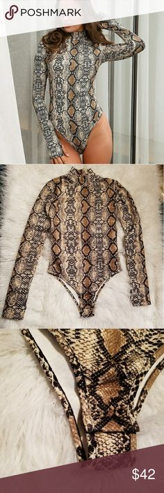 Nwot* Snake Print Bodysuit Brand new!  Lovely soft and stretchy material. Long sleeves with thumb wholes. Snap button closure at bottom.  *This is a size medium however, this does run small and I do believe a small fits it best. (I listed as a small for this reason)  Offers are welcomed! Tops Blouses