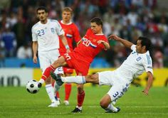 Russia 1 Greece 0 in 2008 in Salzburg. Igor Semshov passes as Christos Patsatzoglou comes in to challenge in Group D at Euro 2008.