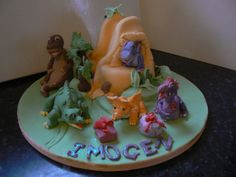 Land Before Time - A cake for a friends grand daughter's 3rd birthday.  I'd never heard of this childrens programme so needed to collate pics thro the web and this is my result!  The dinosaurs are all gumpaste with the mountain and surround cake a cake.