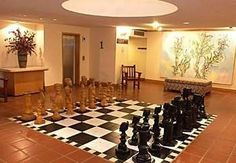 Chess board in the lobby of Piggs Peak Hotel & Casino, Swaziland. Places Ive Been, Stuff To Do, Chess Sets, Table, King, Furniture, Heart, Awesome, Check