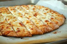 Papa John's Copycat Bread Sticks. ½ pounds Good Pizza Dough  2 Tablespoons Salted Butter, Softened  2 cloves Garlic, Finely Minced  ¼ cups Grated Parmesan Cheese (use The Real Stuff, Not The Stuff In The Green Can)  ¼ pounds Grated Mozzarella Cheese  Salt And Pepper, If Desired