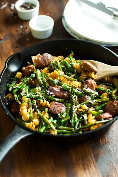 Sausage Asparagus Quinoa Pasta is a quick-to-make combination of quinoa pasta with Italian sausage, asparagus and Parmesan. It is filling and satisfying.