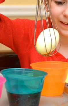 """Genius! Decorating Easter Eggs w/ Kids - To get a good """"grip"""" on your egg, place it inside a wire whisk. No need to worry about the egg rolling off of a spoon! Many more tips here too."""