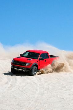 Drive a Ford F-150 Raptor on some sand dunes.