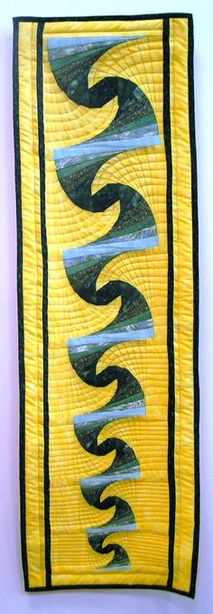 untitled blues and yellow curvy geometric patchwork quilt by Nadide Korbey from Istanbul - lovely quilting accentuates the design