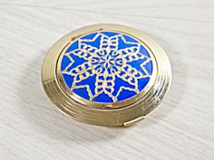 Is Art Deco your thing? How about this? Vintage Blue Cloisonne Hudnut Vanity Compact, Art Deco  http://www.tias.com/cgi-bin/item.fcgi?itemKey=3924154391