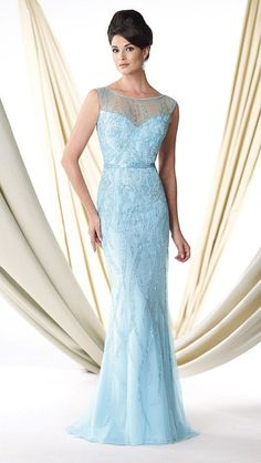 Sleeveless hand-beaded tulle sheath evening dress features an illusion bateau neckline trimmed with beading, sweetheart bodice that features beaded belt at natural waist and beaded illusion back with keyhole, and sweep train.  Perfect as an evening gown